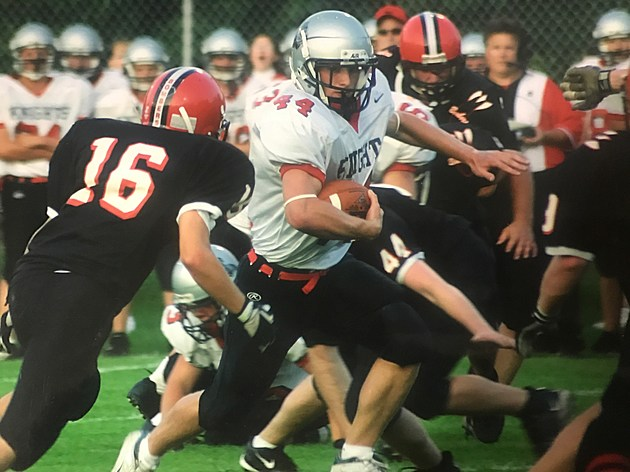 Mikkel Haugen carrying football against Cannon Falls. Picture provided by KHS HOF Committee
