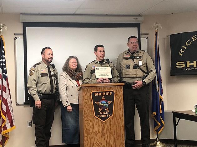 L to R Sheriff Troy Dunn, Kathy Cooper, Deputy Jason Witt, Sgt. Mark Hlady.  Photo by Gordy Kosfeld